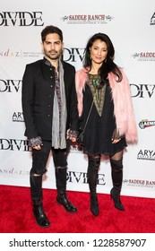 """LOS ANGELES, USA - NOVEMBER 05, 2018: Brayden Pierce (L) and Kelly Hu (R) attends Los Angeles premiere of """"The Divide"""" movie in Laemmle Ahrya Fine Arts Theater in Beverly Hills on November 5, 2018."""