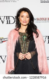 "LOS ANGELES, USA - NOVEMBER 05, 2018: Kelly Hu attends Los Angeles premiere of ""The Divide"" movie in Laemmle Ahrya Fine Arts Theater in Beverly Hills on November 5, 2018."
