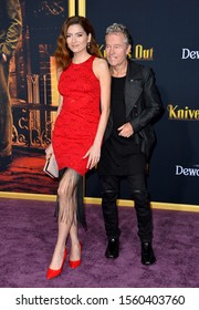 """LOS ANGELES, USA. November 15, 2019: Blanca Blanco & John Savage at the premiere of """"Knives Out"""" at the Regency Village Theatre.Picture: Paul Smith/Featureflash"""