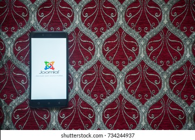 Los Angeles, USA, october 14, 2017: Joomla logo on smartphone screen on red background.