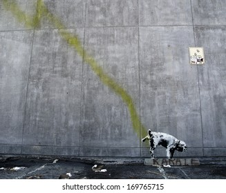 LOS ANGELES, USA - OCTOBER 17: Banksy graffiti on a wall (Pissing dog) on October 17, 2011 in Los Angeles. Banksy's first film, Exit Through the Gift Shop, was nominated for the Academy Award.