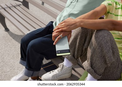 Los Angeles, USA - October 17 2021: A white woman holding the new Google Pixel 6 on her hand sitting on a bench