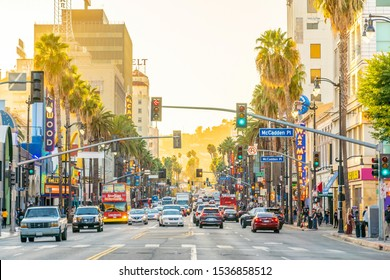 LOS ANGELES, USA - OCTOBER 19, 2019 : View of world famous Hollywood Boulevard district in Los Angeles, California, USA at sunset.