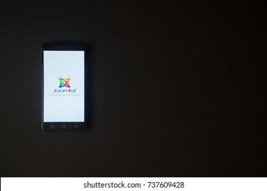 Los Angeles, USA, october 19, 2017: Joomla logo on smartphone screen on black background.