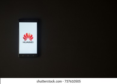Los Angeles, USA, october 19, 2017: Huawei logo on smartphone screen on black background.