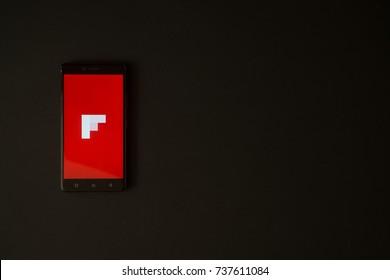 Los Angeles, USA, october 19, 2017: Flipboard logo on smartphone screen on black background.