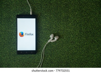 Los Angeles, USA, october 23, 2017: Mozilla firefox logo on smartphone screen on green grass background.