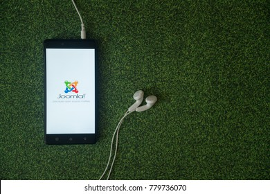 Los Angeles, USA, october 23, 2017: Joomla logo on smartphone screen on green grass background.