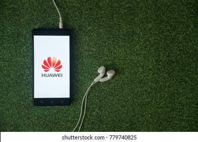 Los Angeles, USA, october 23, 2017: Huawei logo on smartphone screen on green grass background.