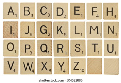 LOS ANGELES , USA - OCTOBER 26, 2016  Alphabet letters on wooden scrabble pieces, isolated on white.