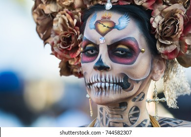 Los Angeles, USA - October 28, 2017: Woman with sugar skull makeup during 18th Annual Dia de los Muertos, Day of the Dead, at the Hollywood Forever Cemetery.