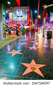 Los Angeles, USA - October 6, 2017 : View of the Hollywood Walk of Fame on the Hollywood Boulevard in Los Angeles at night on October 6, 2017. The Walk of Fame is the most popular attraction in LA.
