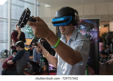 Los Angeles, USA - October 7, 2017: Participant getting experience using VR headset glasses of virtual reality on display during the IndieCade - International Festival of Independent Games.