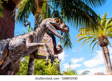 LOS ANGELES, USA - SEP 27, 2015: Velociraptor in Jurassic Park area in the Universal Studios Hollywood Park. Jurassic Park is a 1993 American adventure film  by Steven Spielberg