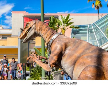 LOS ANGELES, USA - SEP 27, 2015: Realistic velociraptor in Jurassic Park area in the Universal Studios Hollywood Park. Jurassic Park is a 1993  adventure film  by Steven Spielberg