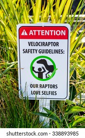 LOS ANGELES, USA - SEP 27, 2015: Attention sign in Jurassic Park area in the Universal Studios Hollywood Park. Jurassic Park is a 1993 American adventure film  by Steven Spielberg