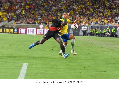 Los Angeles, USA - September 10, 2019: Players struggling to get hold on the ball during International Friendly Soccer match, Brazil vs Peru at the Los Angeles Memorial Coliseum.