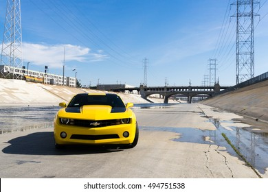 Los Angeles, USA - September 28, 2015: Chevrolet Camaro in Los Angeles river. Historic 6th Street viaduct bridge built in 1932 crossing the L.A. River.