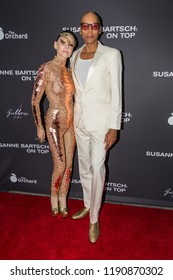 """LOS ANGELES, USA - SEPTEMBER 4, 2018: RuPaul (right) and Susan Bartsch (left) pose on red carpet at Los Angeles premiere of """"Susanne Bartsch: On Top""""."""