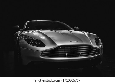 Los Angeles, Year 2017: Aston Martin DB11 in the dark. British supercar. Black and white photography.
