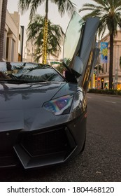 Los Angeles, year 2017: dark gray Lamborghini Aventador Roadster parked on the street. Location: Rodeo Drive, Beverly Hills. Luxurious place, rich lifestyle. Italian supercar.