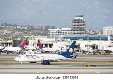 LOS ANGELES/CALIFORNIA - DEC. 17, 2016: Aeromexico Boeing 737 aircraft taxiing along the runway upon arrival to Los Angeles International Airport, Los Angeles, California USA