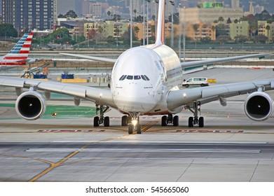 LOS ANGELES/CALIFORNIA - DEC. 29, 2016: Emirates Airbus A380 aircraft taxiing along the runway before departure at Los Angeles International Airport, Los Angeles, California USA