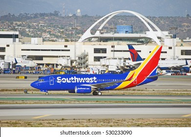 LOS ANGELES/CALIFORNIA - DEC. 3, 2016: Southwest Airlines Boeing 737-7H4 aircraft taxiing along the runway upon arrival at Los Angeles International Airport, Los Angeles, California USA