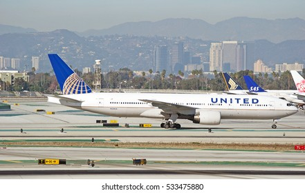 LOS ANGELES/CALIFORNIA - DEC. 4, 2016: United Airlines Boeing 777-222(ER) aircraft taxiing along the runway at Los Angeles International Airport, Los Angeles, California USA