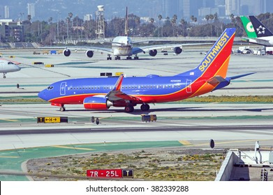 LOS ANGELES/CALIFORNIA - FEB. 21, 2016: Southwest Airlines Boeing 737-7H4 taxiing along the runway upon arrival to Los Angeles International Airport, Los Angeles, California USA