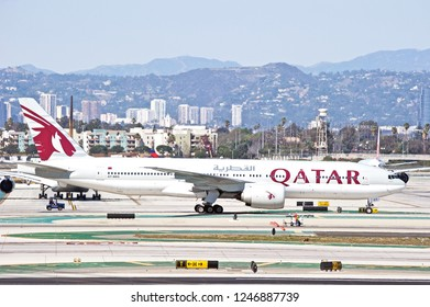 LOS ANGELES/CALIFORNIA - FEB. 24, 2018: Qatar Airways Boeing 777 aircraft taxiing along the tarmac at Los Angeles International Airport. Los Angeles, California USA