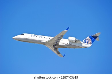 LOS ANGELES/CALIFORNIA - FEB. 24, 2018: United Express Bombardier CRJ-200ER aircraft is airborne as it departs Los Angeles International Airport. Los Angeles, California USA