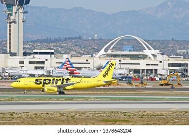 LOS ANGELES/CALIFORNIA - FEB. 24, 2018: Spirit Ailines Airbus A320 aircraft taxiing along the runway upon arrival at Los Angeles International Airport. Los Angeles, California USA
