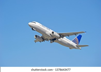 LOS ANGELES/CALIFORNIA - FEB. 24, 2018: United Airlines Airbus A320 aircraft is airborne as it departs Los Angeles International Airport. Los Angeles, California USA