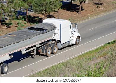 LOS ANGELES/CALIFORNIA - FEB. 24, 2018: Rock hauler truck cruising along the highway. Los Angeles, California USA