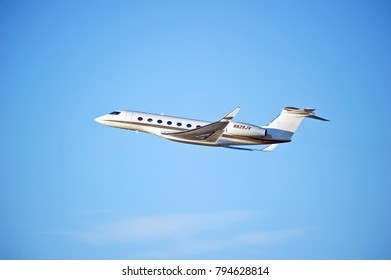 LOS ANGELES/CALIFORNIA - JAN. 14, 2018: Privately owned Gulfstrea G650 is airborne as it departs Los Angeles International Airport. Los Angeles, California USA
