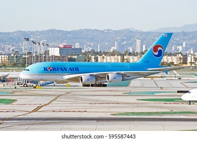 LOS ANGELES/CALIFORNIA - JAN 27, 2017: Korean Airlines Airbus A380-861 aircraft being towed across the tarmac at Los Angeles International Airport, Los Angeles, California USA