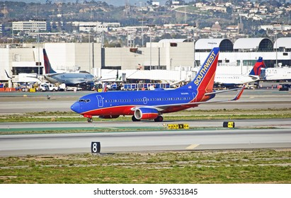 LOS ANGELES/CALIFORNIA - JAN 27, 2017: Southwest Airlines Boeing 737-7H4 aircraft taxiing along the runway upon arrival at Los Angeles International Airport, Los Angeles, California USA