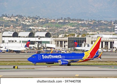LOS ANGELES/CALIFORNIA - JAN 27, 2017: Southwest Airlines Boeing 737-8H4(WL)  aircraft taxiing along the runway upon arrival at Los Angeles International Airport, Los Angeles, California USA