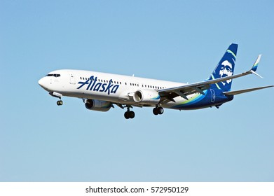 LOS ANGELES/CALIFORNIA - JANUARY 27, 2017: Alaska Airlines Boeing 737-990(ER) aircraft seconds away from touching down on the runway at Los Angeles International Airport, Los Angeles, California USA
