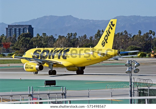 LOS ANGELES/CALIFORNIA - JANUARY 27, 2017: Spirit Airlines Airbus A319-132 aircraft taxiing along the runway before take off at Los Angeles International Airport, Los Angeles, California USA