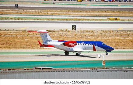 LOS ANGELES/CALIFORNIA - JULY 14, 2018: Luxembourg Air Rescue Learjet 45XR ambulance aircraft taxiing along the taxiway upon arrival at Los Angeles International Airport. Los Angeles, California USA