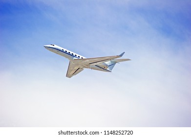 LOS ANGELES/CALIFORNIA - JULY 21, 2018: Privately owned Gulfstream G550 fixed wing multi-engine aircraft is airborne as it departs Los Angeles International Airport. Los Angeles, California USA