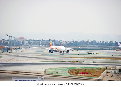 LOS ANGELES/CALIFORNIA - JUNE 23, 2018: Hong Kong Airlines Airbus A350 aircraft taxiing along the runway before take off at Los Angeles International Airport. Los Angeles, California USA
