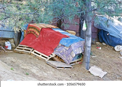 LOS ANGELES/CALIFORNIA - MARCH 25, 2018: Homeless encampment along the roadside depicting the growing epidemic of homelessness in the City of Los Angeles. Los Angeles, California USA