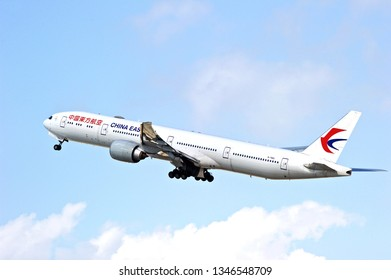 LOS ANGELES/CALIFORNIA - MARCH 9, 2019: China Eastern Airlines Boeing 777 aircraft is airborne as it departs Los Angeles International Airport. Los Angeles, California USA