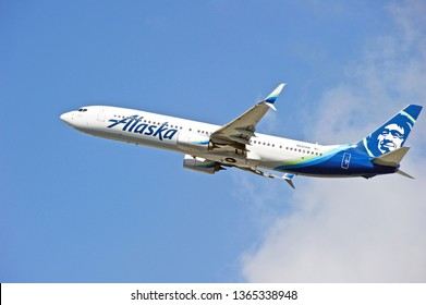 LOS ANGELES/CALIFORNIA - MARCH 9, 2019: Alaska Airlines Boeing 737-900(ER) aircraft is airborne as it departs Los Angeles International Airport. Los Angeles, California USA