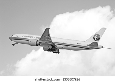 LOS ANGELES/CALIFORNIA - MARCH 9, 2109: China Cargo Boeing 777 aircraft is airborne as it departs Los Angeles International Airport. Los Angeles, California USA