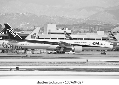 LOS ANGELES/CALIFORNIA - MARCH 9, 2109: All Nippon Airways Boeing 777 aircraft taxiing along the tarmac before departure at Los Angeles International Airport. Los Angeles, California USA