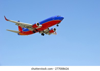 LOS ANGELES/CALIFORNIA - MAY 10, 2015: Southwest Airlines commercial jetliner on approach to runway at Los Angeles International Airport in Los Angeles, California, USA